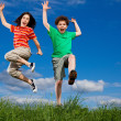 Girl and boy jumping — Stock Photo #4643339