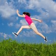 Girl jumping outdoor — Stock fotografie