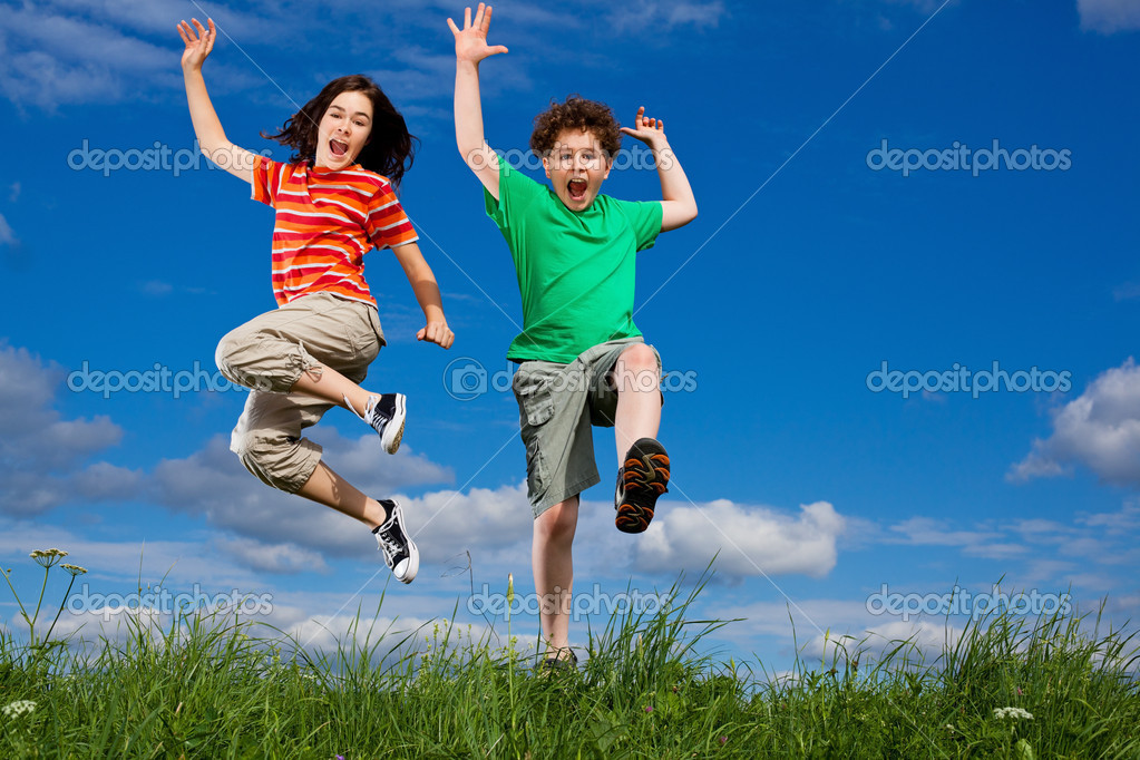 Girl and boy jumping, running against blue sky — Stock Photo #4643339