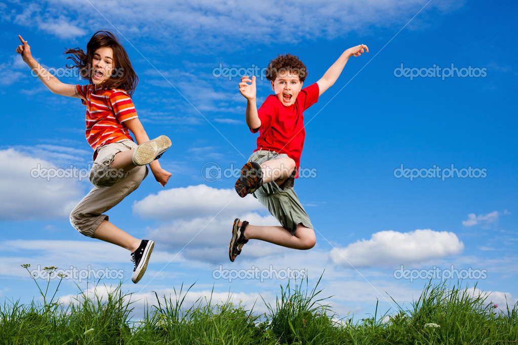Girl and boy jumping, running against blue sky  Stock Photo #4643348