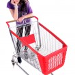 Unhappy girl with shopping cart — Stock Photo
