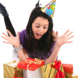 Beautiful happy girl with a gifts — Stock Photo