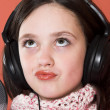 Girl listening music in headphones — Stock Photo #3941019