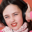 Stock Photo: Girl listening music in headphones