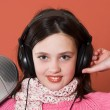 Stock Photo: Pretty girl listening music