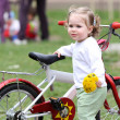 Girl with flower and bicycle — Stock Photo