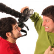 Stock Photo: Two Professional photographers fighting