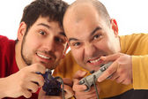 Two young men playing video game console controller — Stock Photo