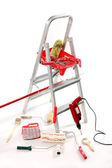 Paint roller, brushes, borer and ladder — Stock Photo