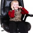 Child businessman boss calling by phone — Stock fotografie