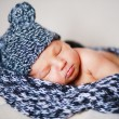 Adorable newborn baby in a hat — Stock Photo