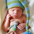 Adorable newborn baby with teddy - ストック写真