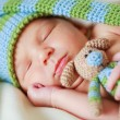 Adorable newborn baby with teddy — Stok Fotoğraf #3955190