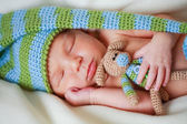Adorable newborn baby with teddy — ストック写真