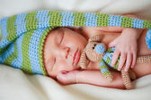 Adorable newborn baby with teddy — Stock Photo