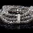 Stock Photo: Bracelet with diamonds on black