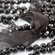 Black beads on white — Foto Stock
