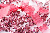 Pink beads on white — Stock Photo