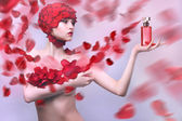 Beautiful girl with a rose petals — Stock Photo
