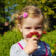 Stock Photo: Little girl with flower