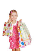 Happy little girl with shopping bags — Stock Photo