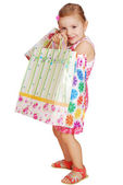 Little girl holding shopping bags — Stock Photo