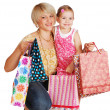 Happy mother and daughter with shopping bags — Stock Photo