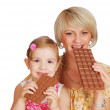 Mother and daughter with chocolate — Stock Photo