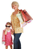 Mother and daughter with shopping bags — Stock Photo
