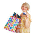 Woman with credit card and shopping bags — Stock Photo
