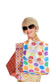 Woman with shopping bags and sunglasses — Stock Photo