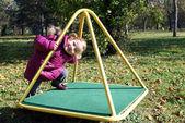Little girl in park playground — Stock Photo