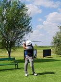 Senior golf player hit ball — Stock Photo