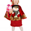 Happy little girl Santa Claus with gift — Stock Photo