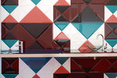 Kitchen with colorful tiles wall — Stock Photo