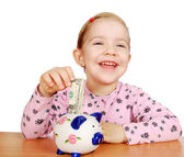 Happy little girl with piggy bank — Foto de Stock