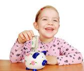 快乐的小女孩与小猪银行 — 图库照片