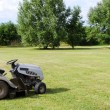 Lawn mower on field — Foto de Stock