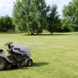 Stock Photo: Lawn mower on field