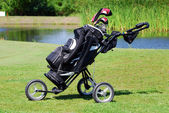 Golf bag on field — Stock Photo