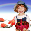 Stock Photo: Happy little girl with strawberries