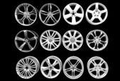 Car wheel aluminum rims isolated on black — Stock Photo