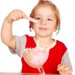 Little girl enjoying ice cream — Stock Photo