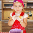 Little girl make rolls in kitchen — Stock Photo