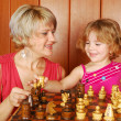 Mother and daughter play chess — Stock Photo