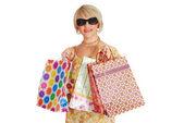 Frau mit sonnenbrille und shopping bag — Stockfoto