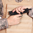 Soldier with pistol — Stock Photo
