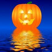 Halloween Pumpkin in water — Stock Photo