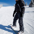 Stock Photo: Snowboard beginner