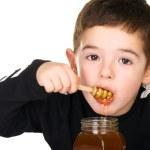 chłopiec i miód — Zdjęcie stockowe #3948608